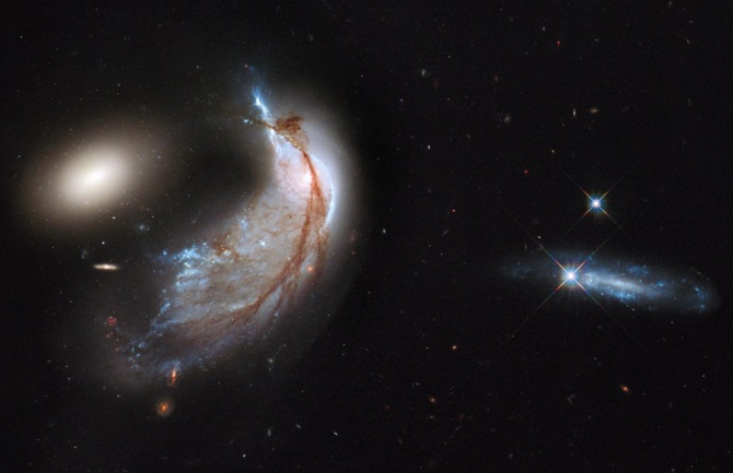 The cosmos dynamic and, in many cases, violent. This image of Arp 142 shows a collision between galaxies. The culprit: gravity.