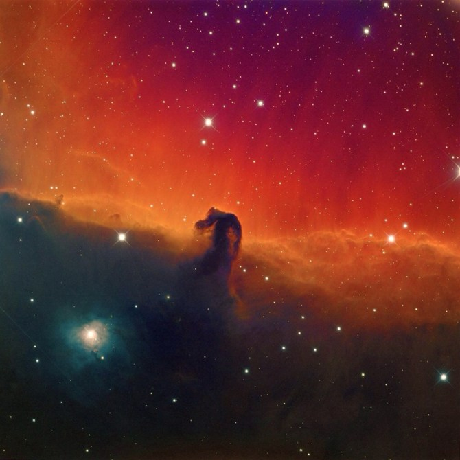 "This is the Horsehead Nebula: ""The red or pinkish glow originates from hydrogen gas predominantly behind the nebula, ionized by the nearby bright star Sigma Orionis."""